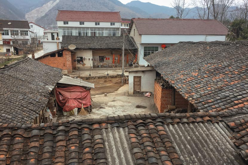 A view of the Wang family's courtyard (with the red cloth) from the second floor of the Zhang family home in Wangping Village, Shaanxi province, Feb. 20, 2018. Wang Jian for Sixth Tone