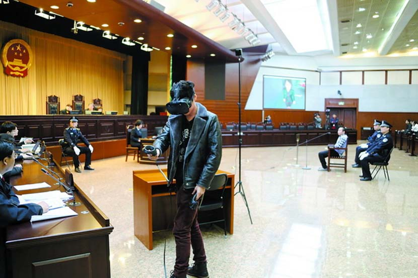 A witness wearing a virtual reality headset re-enacts a crime during an intentional homicide trial in Beijing, March 1, 2018. From Weibo