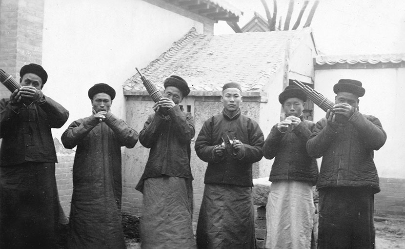 A folk band plays at an event in Yantai, Shandong province, in the early 1900s. Courtesy of 'Old Photos'