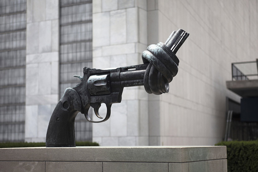 A sculpture of a knotted Colt Python revolver stands at the UN headquarters in New York City. Topic Images/VCG