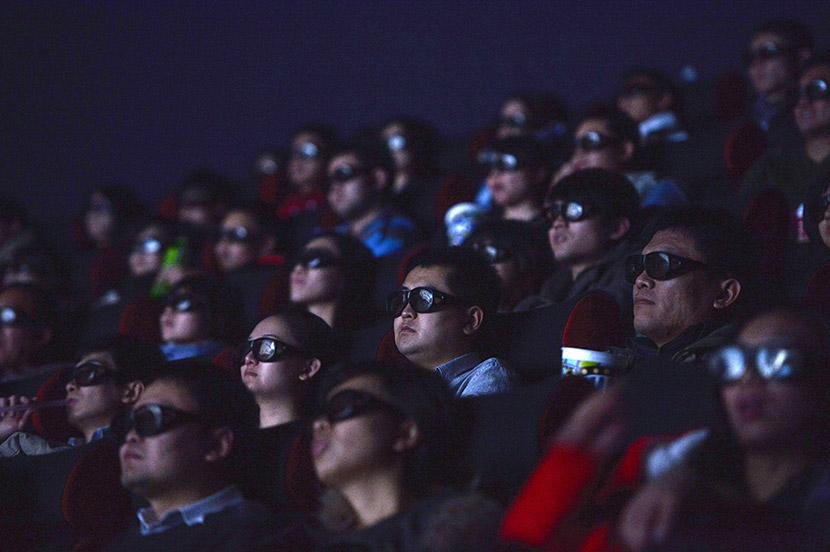 People watch a film at a cinema in Shijiazhuang, Hebei province, Nov. 24, 2013. Chen Jianyu/VCG